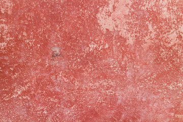 Crack red painted wall texture background.
