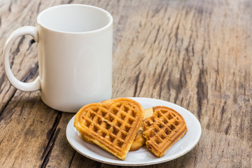 waffles heart shaped  and coffee cup for breakfast