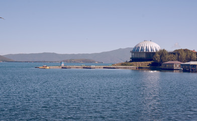 Sevan lake with houses, buildings and mountains