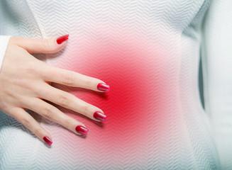 Woman having menstrual pain or stomach ache