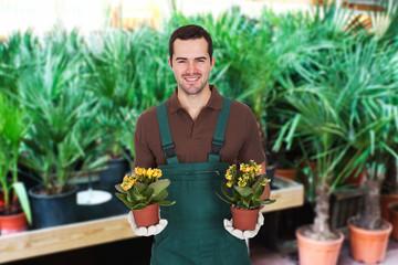Male Gardener Carrying Two Flowerpots