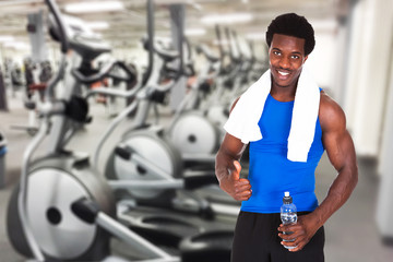 Young Athlete Man Showing Thumb Up Gesture At Gym
