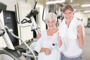 Senior Couple Showing Thumb Up Gesture At Gym