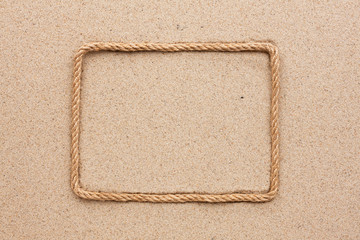 Frame made of rope lying on the sand