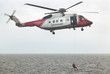 Coastguard rescue helicopter team in action. Scotland. UK - 77691270