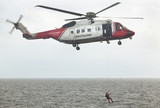 Coastguard rescue helicopter team in action. Scotland. UK