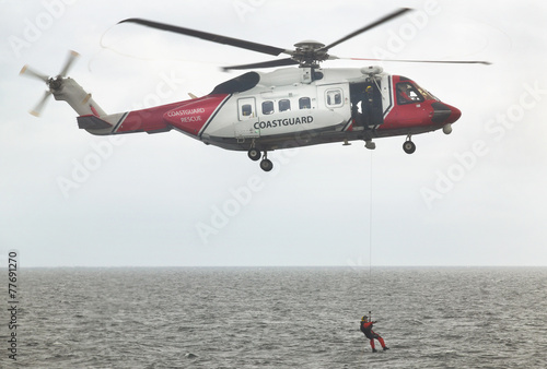 Poster Helicopter Coastguard rescue helicopter team in action. Scotland. UK