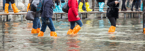 Aluminium Venetie Close Up of legs with boots due to the high water in Venice.