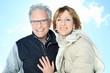 Portrait of happy senior couple in winter season - 77691613