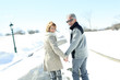 Portrait of happy senior couple in winter season - 77691699