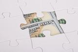American Banknote Hidden Under Jigsaw