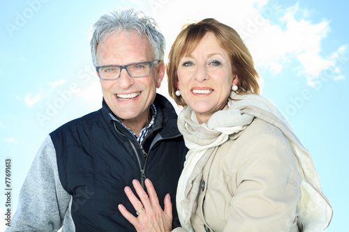 Portrait of happy senior couple in winter season - 77691613