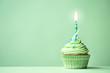 Leinwandbild Motiv Green birthday cupcake