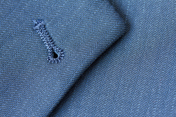 Close up detail of buttonhole on suit lapel
