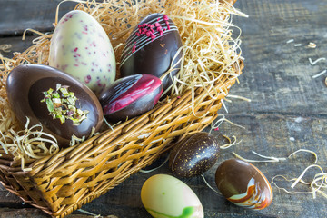 Chocolate easter eggs on rustic wooden background
