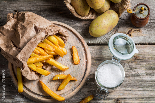Homemade fries made of fresh potato - 77693473