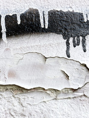 Small part of a wall painted in black and white