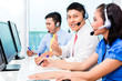 Asian Chinese call center agent team on phone