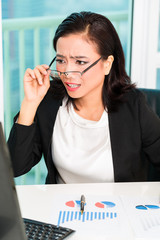 Asian Chinese businesswoman in office