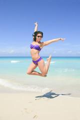 A beautiful woman on a tropical beach cuba