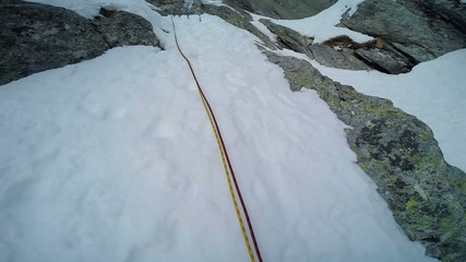 Ice climbing on a route of snow and rock