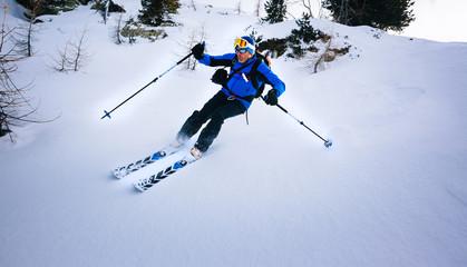 Winter sport: man skiing in powder snow.