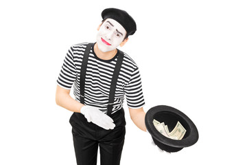 Mime artist collecting money in a hat
