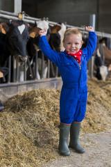 kind op de boerdeij