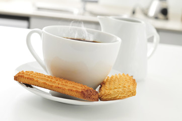 coffee and biscuits on the kitchen table