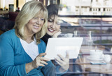 Mature women with digital tablet