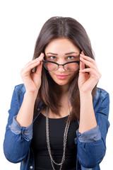 beautiful girl looks over glasses