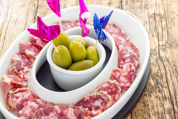 Appetizer of salami and olives