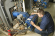 Leinwanddruck Bild - repairman engineer or inspector who check the system.