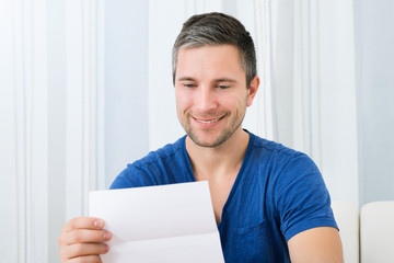 Happy Man Holding Letter