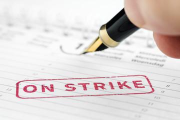Close up of on strike stamp