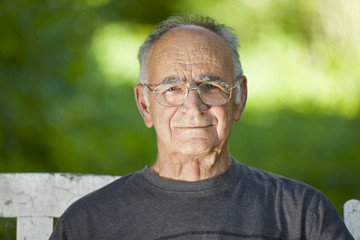 Portrait Of A Elderly Man Smiling At The Camera
