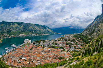The Kotor bay, old city roofs and port. Adriatic sea beach and m