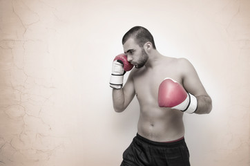 Young boxer contrasty artistic image on grunge background