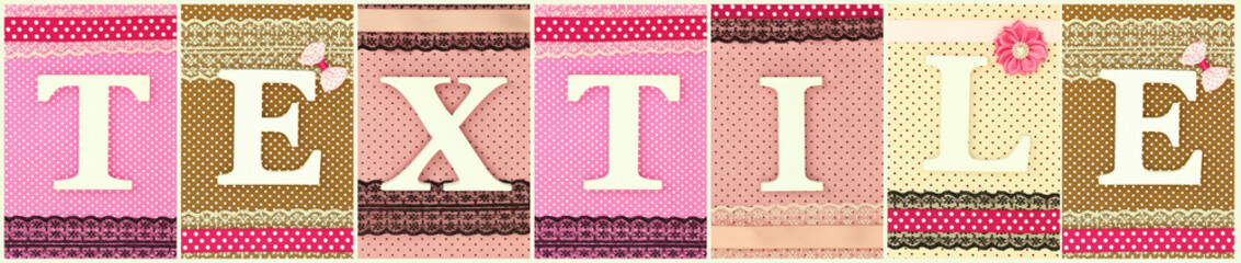 Word Textile with wooden white letters on polka dots background