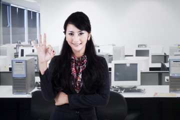 Businesswoman gesturing okay 2