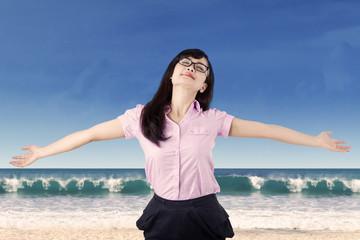 Carefree woman enjoying freedom at beach