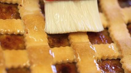 Brush glaze the cake in pastry