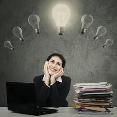 Cheerful worker under lightbulb