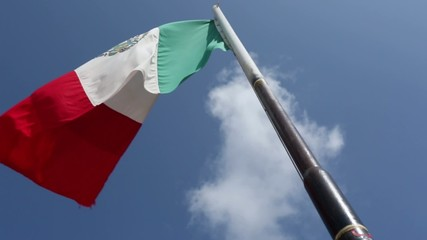 Mexican Flag Blowing in the Wind during the day.