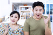 Excited couple expression at home