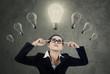 Female manager thinking idea under lightbulbs