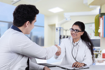 Friendly doctor with male patient