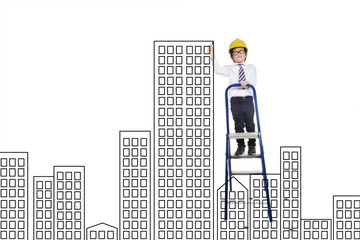 Little boy drawing a building construction