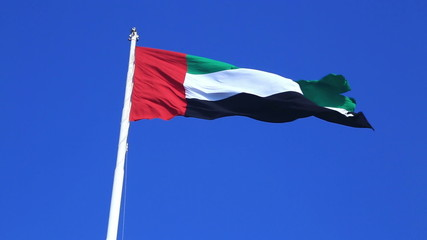 Flag of the United Arab Emirates and blue sky
