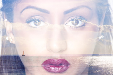 Double exposure of closeup female portrait and seascape